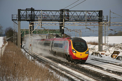 A Pendolino sweeps round the curves between Tring and Cow Roast, kicking up the snow as it does so. If a southbound working passes here at full line speed, the driver of one of these trains need only freewheel the rest of the 30 miles to London and yet still keep time. 18/12/09