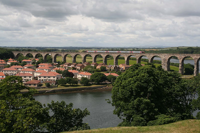 High above the town and the River Tweed, a Cross Country 'Voyager' unit approaches Berwick from the south. 5/7/10