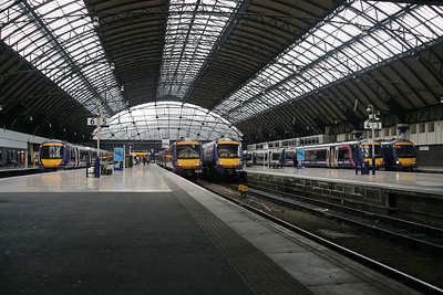 If you like class 170s, Glasgow Queen Street is the place to be; they are coming and going all day long.170403, 170457, 170456, 170396 & 170453 are populating the platforms in this view. 6/7/09