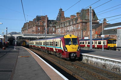 Class 334s ruled the Ayrshire Coast line when this was taken. Not any more!156476 and 318255 wait their turn as 334020 leaves Ayr for Glasgow Central. 10/4/09