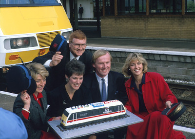 When the class 90s were the newest thing on BR! 90001 was named 'BBC Midlands Today' (marking the show's 25th anniversary) at Birmingham International and the presenters of the show were invited to do it: Alan Towers, Kay Alexander, Diana Kemp, David Davis and Sue Beardsmore. Alan is sadly no longer with us, Kay still reads the news, David is a leading light at the Football Association whilst Diana and Sue have gone on to further work in the media world. As for the cake, well that got rapidly scoffed by a group of local schoolkids who'd also come along. I didn't get any but a cab ride in that loco more than compensated! 28/9/89