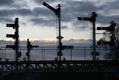 Not long before it was removed, a silhouette of the famous semaphore signal gantry at Falsgrave, Scarborough. 5/12/09