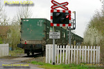 "The end of another era as the last run of 4V60, the empties working of the ""Avon Binliner"", clears the level-crossing at the site of the former Launton station on the Oxford to Cambridge line at 11:46. This was hauled by 66548 on Friday 1st April 2011. Digital Image No. GMPI8454."