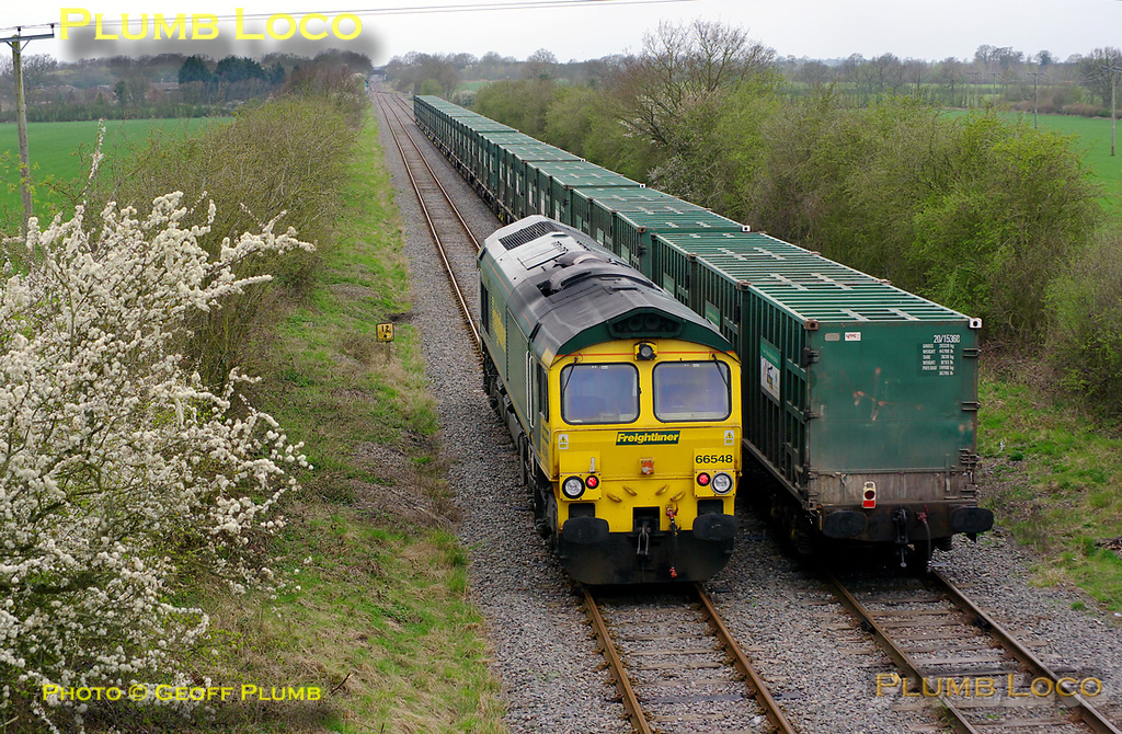 """66548 runs round its train in the loop at Claydon L&NE Junction having brought it round the curve from Calvert. This was the last run of 4V60, the 10:57 from Calvert to Bristol empty """"Avon Binliner"""", 11:25, Friday 1st April 2011. Digital Image No. GMPI8447."""