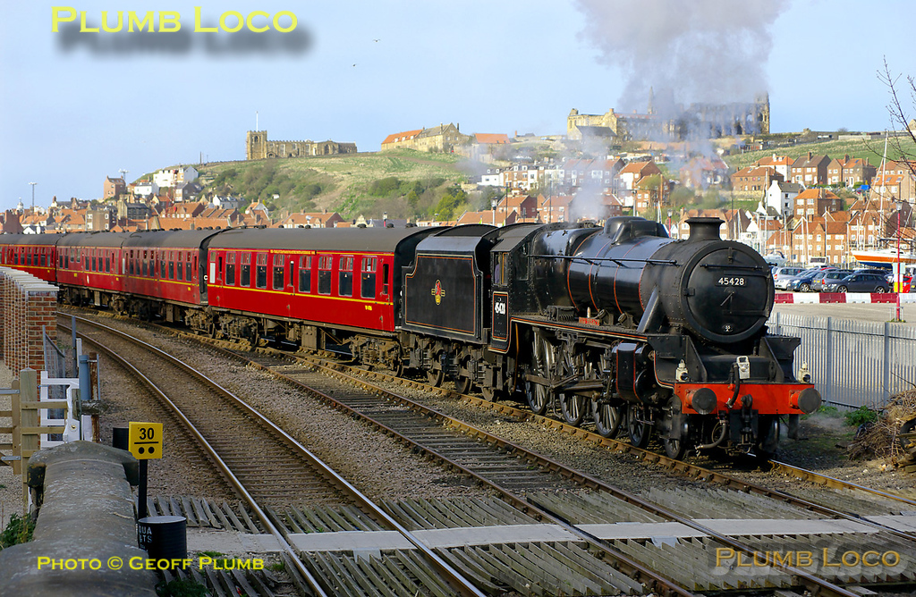 "Having arrived in Whitby with the 16:10 train from Grosmont, ""Black 5"" 4-6-0 No. 45428 ""Eric Treacy"" had propelled the stock out from the station to the loop at Bog Hall. After running round the stock, the engine is now propelling it back into the station prior to departure at 17:30 for Pickering. The glorious sunshine picks out the Abbey and St. Mary's church on the East Cliff, 17:17, Saturday 9th April 2011. Digital Image No. GMPI8521."