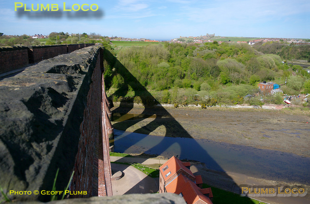 View from the south end of Larpool Viaduct looking towards Whitby, with St Mary's Church and the Abbey visible on the horizon. The tide is well out on the River Esk, and the line from Grosmont which comes under the north end of the viaduct can be seen curving left by the site of the old gasworks. Sunday 10th April 2011. Digital Image No. GMPI8564.