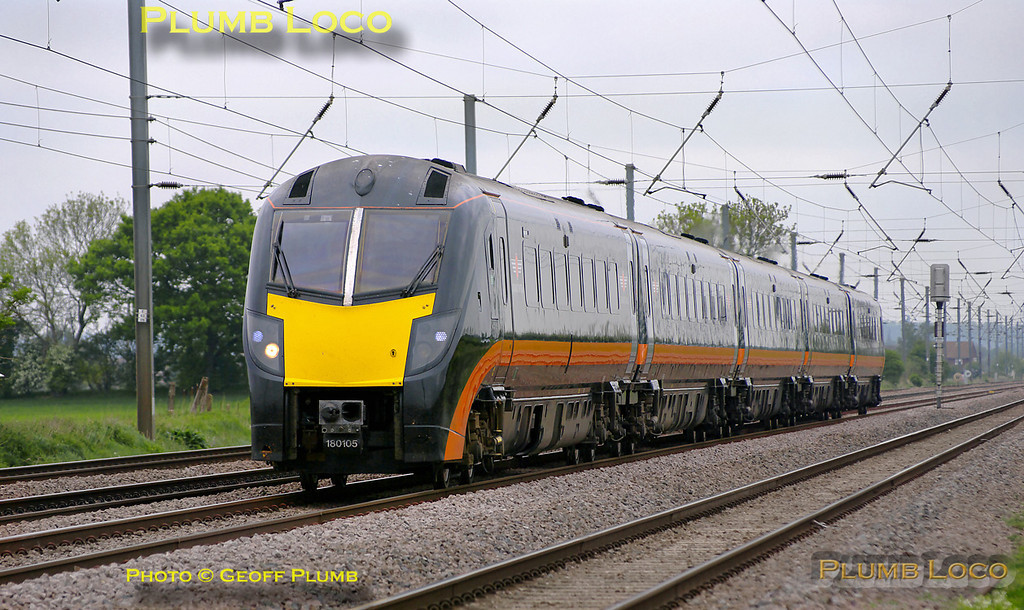 "Grand Central ""Adelante"" 180 105 is approaching the foot-crossing at Langford with an up working to King's Cross, though whether from Bradford or Sunderland I'm not sure. 09:57, Thursday 28th April 2011. Digital Image No. GMPI8819."
