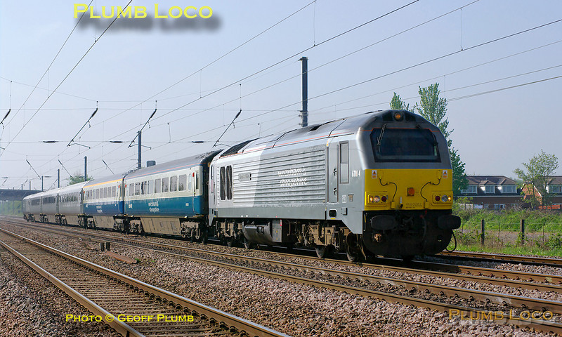 "W&S 67014 ""Thomas Telford"" is at full speed on the ECML with a mixed set of Chiltern LHCS Mk.3 coaches and DVT 82301 on the rear. This was the 08:30 from Wembley LMD, running as 5E67, to Doncaster Wabtec, where the coaches are to be fitted with plugdoors for future use with Chiltern Railways. The train is approaching the foot-crossing at Langford at 10:18, running around 30 minutes early on Tuesday 19th April 2011. The set consists of two Mk.3 coaches in blue/grey livery with W&S branding, plus two TSOs and an RFM/GFW in debranded W&S silver livery, whether they are to be repainted at Wabtec is perhaps open to speculation! Digital Image No. GMPI8769."