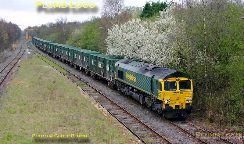 "Freightliner 66548 starts away from the unloading gantry at Calvert with what was reported as being the last working of 4V60, the 10:57 empty ""Avon Binliner"" train to Bristol, at 11:06 on Friday 1st April 2011. The yellow container under the gantry in the background had been dropped into position only a few minutes earlier, across the centre track, so whether this is now out of use, I'm not sure. The Northolt empty bins usually depart south from this line as the two trains are there at the same time, but presumably that will not apply in the future... Digital Image No. GMPI8429."