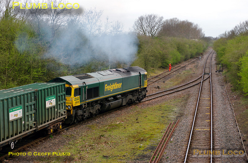 """The Freightliner groundstaff shunter has set the road and 66548 clags away from Calvert with the last run of 4V60, the 10:57 from Calvert to Bristol empty """"Avon Binliner"""". It then takes the curve round to Claydon L&NE junction to run round the train before heading for Bicester and Oxford. The former Great Central main line ran straight ahead at this location, now long disused and lifted. However, if HS2 gets built on the suggested alignment, it will be more or less where the loco is in this picture and continue straight ahead. 11:08, Friday 1st April 2011. Digital Image No. GMPI8431."""