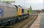 GBRf 66709 in Medite livery is passing Whitley Bridge station with 4H81, the 11:15 from Drax Power Station to Hull coal empties. This train reverses at Sudforth Lane sidings, presumably, in order to make its way back to Hull. 12:35, Thursday 14th April 2011. The junction for Eggborough Power Station is just beyond the bridge and then the grade up to Hensall. Digital Image No. GMPI8675.