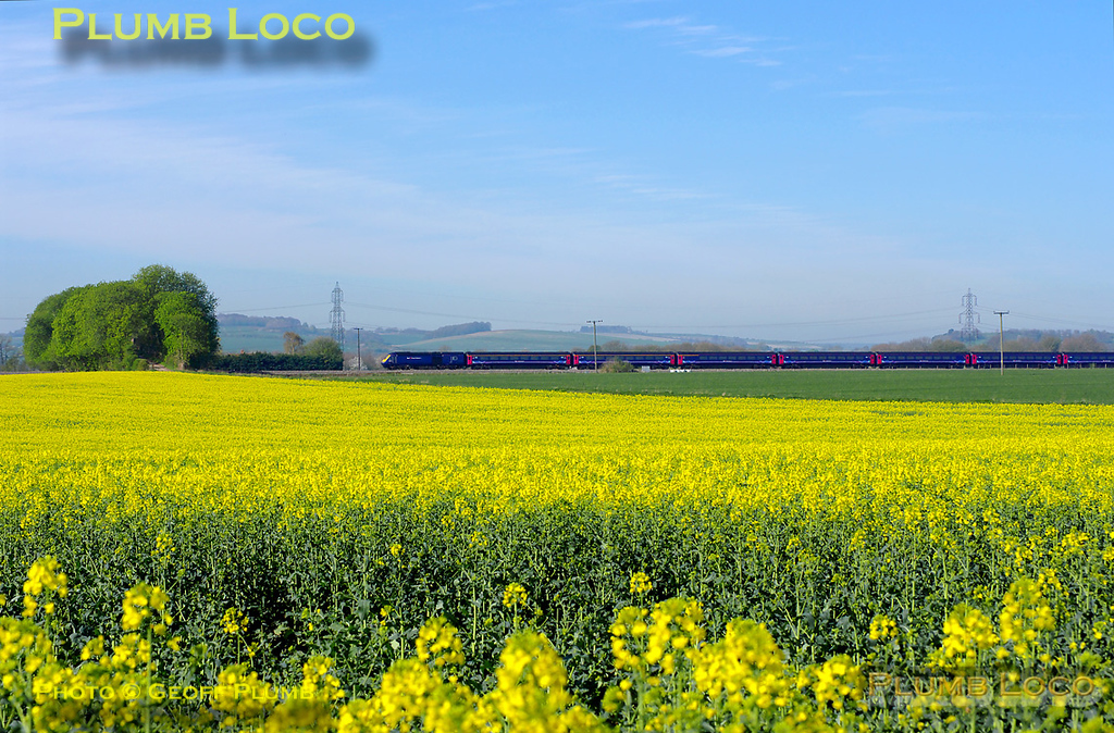 Seen across the rapeseed fields at Cholsey Manor Farm, an unidentified FGW HST makes its way towards Paddington at 10:01 on the lovely spring morning of Thursday 7th April 2011. Digital Image No. GMPI8498.