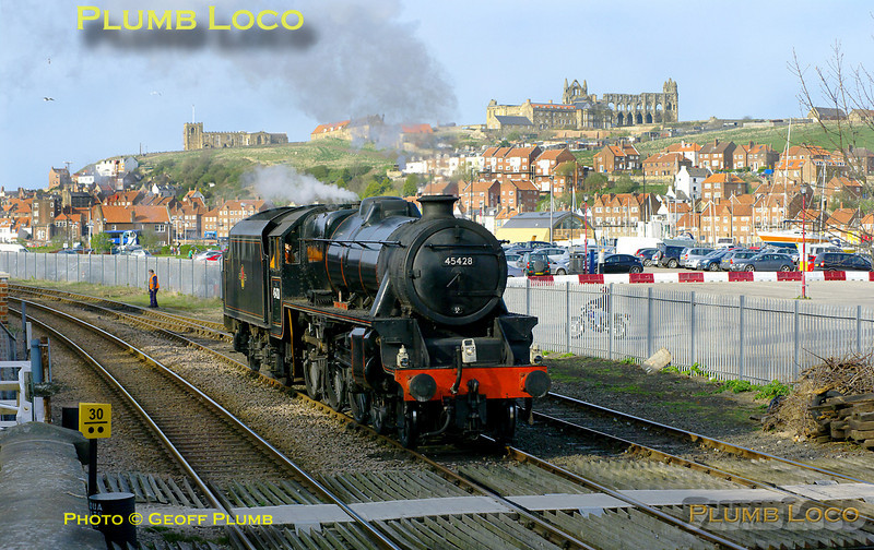 """Having arrived in Whitby with the 16:10 train from Grosmont, """"Black 5"""" 4-6-0 No. 45428 """"Eric Treacy"""" has propelled the stock out from the station to the loop at Bog Hall and is now running round the stock, out of picture to the right. The glorious sunshine picks out the Abbey and St. Mary's church on the East Cliff, 17:11, Saturday 9th April 2011. Digital Image No. GMPI8515."""