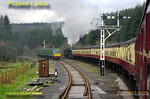 Trains passing at Levisham were somewhat delayed as engines were swapped over so that 45428 could work through to Whitby with the 12:00 train from Pickering. The crew of the loco set off from Levisham in fine style, attempting to make up lost time as the train passes the DMU stabled in the siding. 12:37, Monday 11th April 2011. Digital Image No. GMPI8587.