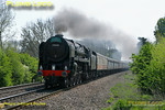 "BR Standard 4-6-2 No. 70000 ""Britannia"" is hard at work at the head of the 12 coach 1Z40, ""The Cathedrals Express"", 09:36 from Paddington to Stratford-upon-Avon. It is approaching the foot-crossing at Wormleighton a few minutes early at 12:11 on Saturday 23rd April 2011. This was the hottest day of the year so far, but with the loco working hard and being fired, some visible exhaust is apparent. The loco is still carrying its unlined black livery and is without its nameplates. Digital Image No. GMPI8818."