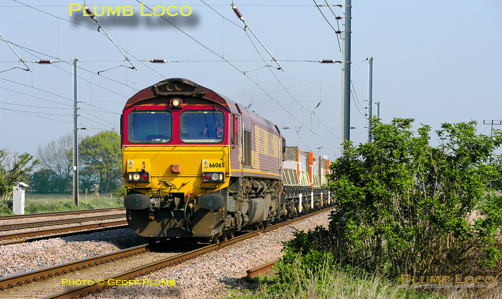 DBS 66065 heads south on the ECML on the up slow at the foot-crossing at Langford with 6L69, the 05:15 from Peterborough Yard to Biggleswade and on to Bow loaded Plasmor blocks train, 10:25, Tuesday 19th April 2011. Digital Image No. GMPI8732. Digital Image No. GMPI8775.
