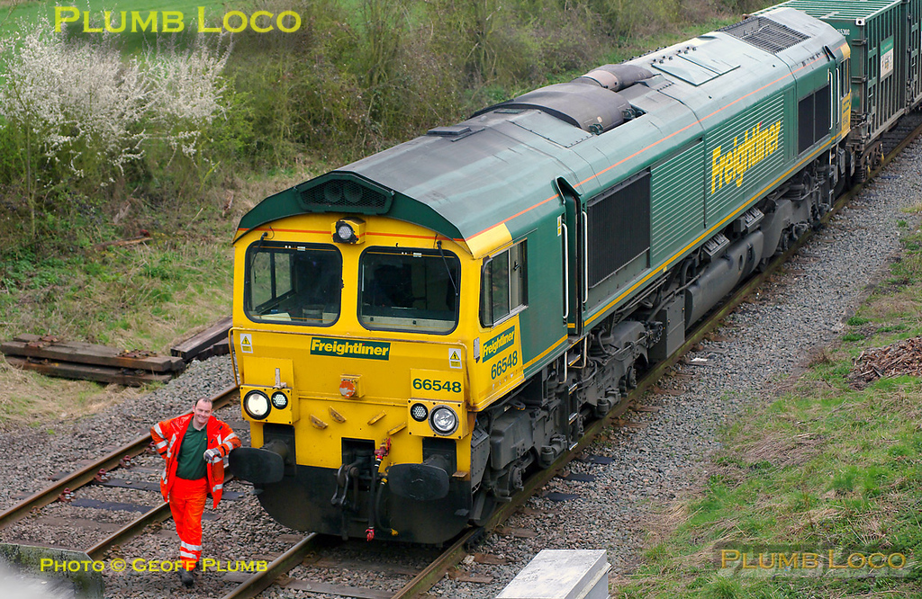 """The Freightliner groundstaff shunter stands by the loco for the driver to take a photo just before 66548 sets off to run round the train at Claydon L&NE Junction loop. This was the last run of 4V60, the 10:57 Calvert to Bristol empty """"Avon Binliner"""" train. 11:21, Friday 1st April 2011. Digital Image No. GMPI8442."""