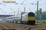 "W&S 67014 ""Thomas Telford"" is at full speed on the ECML with a mixed set of Chiltern LHCS Mk.3 coaches and DVT 82301 on the rear. This was the 08:30 from Wembley LMD, running as 5E67, to Doncaster Wabtec, where the coaches are to be fitted with plugdoors for future use with Chiltern Railways. The train is approaching the foot-crossing at Langford at 10:18, running around 30 minutes early on Tuesday 19th April 2011. The set consists of two Mk.3 coaches in blue/grey livery with W&S branding, plus two TSOs and an RFM/GFW in debranded W&S silver livery, whether they are to be repainted at Wabtec is perhaps open to speculation! Digital Image No. GMPI8766."