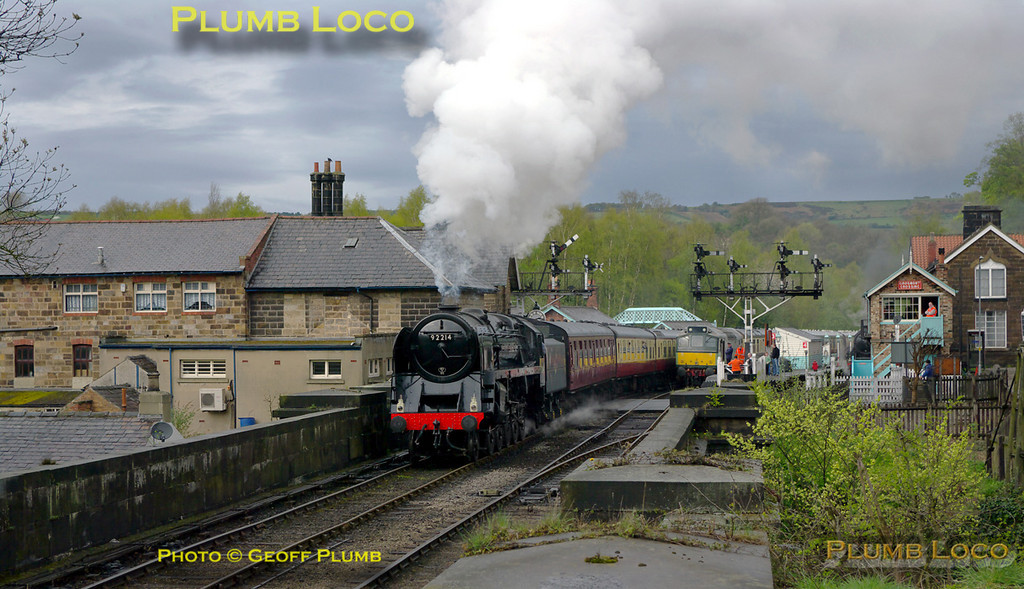 9F 92214 departs from Grosmont with the 14:00 train from Whitby which had arrived behind 45428 and exchanged engines once again before leaving for Pickering at 14:41, around 11 minutes late. Monday 11th April 2011. Digital Image No. GMPI8592.