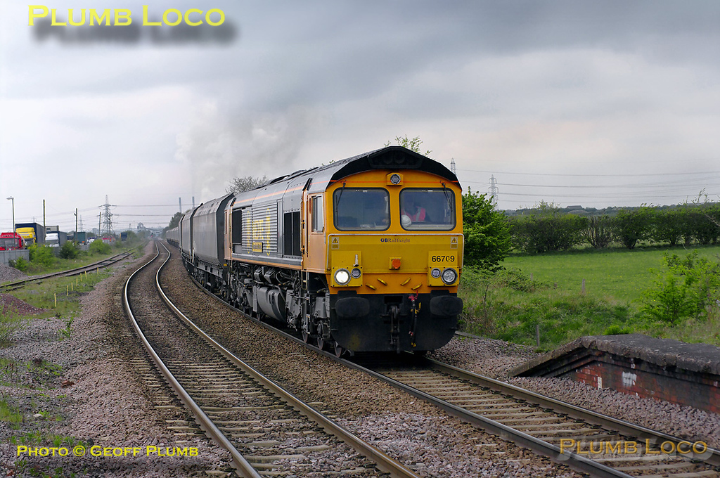 GBRf 66709 in Medite livery is entering Whitley Bridge station with 4H81, the 11:15 from Drax Power Station to Hull coal empties. This train reverses at Sudforth Lane sidings, presumably, in order to make its way back to Hull. 12:35, Thursday 14th April 2011. Digital Image No. GMPI8674.
