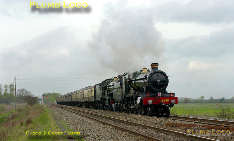 """GWR 4-6-0s Nos. 4965 """"Rood Ashton Hall"""" and 5043 """"Earl of Mount Edgcumbe"""" are double heading 1Z45, """"The Coronation Express"""", Tyseley Warwick Road to Didcot via Cheltenham and Swindon. They have just passed the site of Wantage Road station and have opened up for the final stretch to Didcot, running some ten minutes early at 11:44 on Saturday 2nd April 2011. The train was run in conjunction with the public launch of restored 6023 """"King Edward II"""" at Didcot Railway Centre. Photo taken from a public footpath across the line. Digital Image No. GMPI8468."""