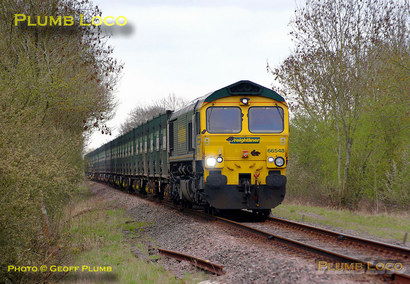 """66548 is in charge of the last run of 4V60, the 10:57 Calvert to Bristol empty """"Avon Binliner"""" train. It had departed from Calvert at 11:08 and run round the train at Claydon L&NE Junction. It is now  en route to Bicester and Oxford, approaching the level-crosssing at the old station at Launton. 11:46, Friday 1st April 2011. Digital Image No. GMPI8449."""
