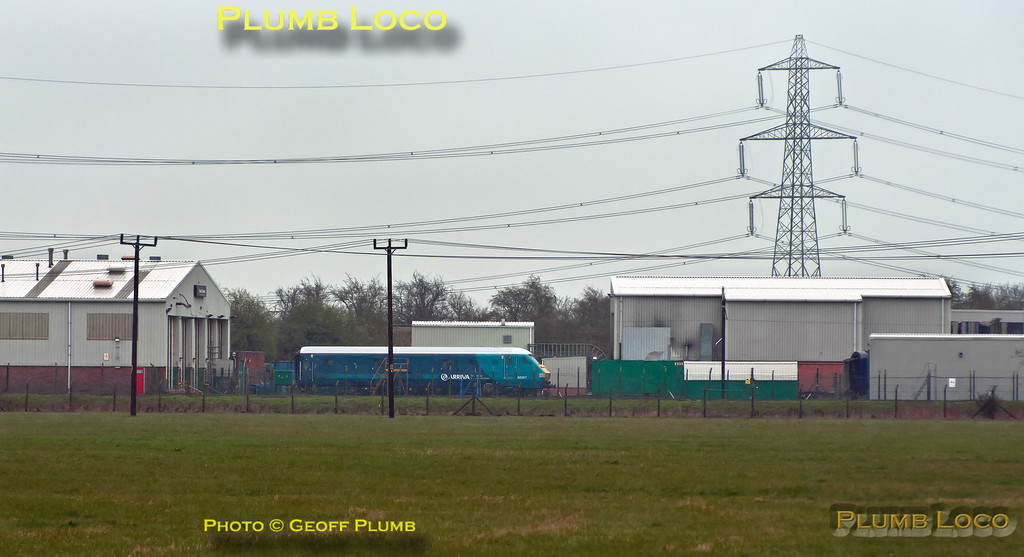 Newly refurbished DVT No. 82307 now carries Arriva Trains Wales livery and is here sitting in the yard at Brush, Loughborough. Chiltern's 67012 was en route to collect it and return it to Wembley LMD where it will join their fleet for a while. Photo taken across the fields in a strong wind and horizontal sleet, so apologies for the quality! 13:32, Wednesday 4th April 2012. Digital Image No. GMPI11517.