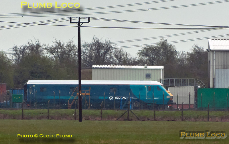 Newly refurbished DVT No. 82307 now carries Arriva Trains Wales livery and is here sitting in the yard at Brush, Loughborough. Chiltern's 67012 was en route to collect it and return it to Wembley LMD where it will join their fleet for a while. Photo taken across the fields in a strong wind and horizontal sleet, so apologies for the quality! 13:32, Wednesday 4th April 2012. Digital Image No. GMPI11517a.