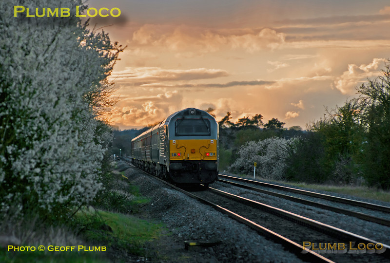 """Chiltern 67014 """"Thomas Telford"""" brings up the rear of 1U53, the 18:13 from Marylebone to Banbury LHCS service, with ATW DVT 82307 leading the train. It has just passed the foot-crossing at Kingsey, next stop at Haddenham & Thame Parkway under a dramatic sky. 18:52, Tuesday 10th April 2012. Digital Image No. GMPI11560."""
