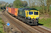 Freightliner 66416 is seen working hard at Silchester, with 4O09 Crewe Basford Hall to Southampton Intermodal 23/04/2015.