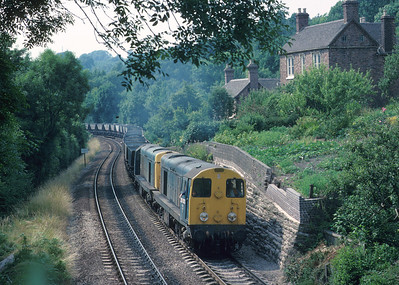 Its a hot and sticky July afternoon that finds 20013/087 slogging out of the Severn Valley at Ironbridge with MGR empties returning to the Midlands coalfield. Over the following 3-4 years, new class 60s would see the end of these type 1s on coal trains. Note the repairs going on to the garden wall, with proper engineering bricks. 20/7/89