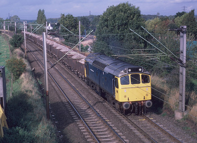 25322 'Tamworth Castle', nicknamed the 'Ice Cream Van' because of its enhanced livery, was the last of its type to be withdrawn. It had less than two years' service remaining when it approached Wolverhampton from the Stafford direction with these loaded wagons. 9/10/85