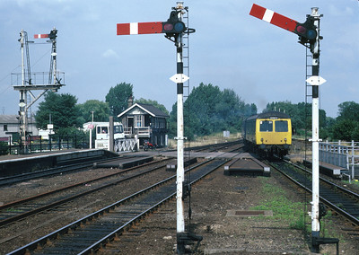 A scene at Ely before electrification with a Cravens class 105 DMU leaving the station. 19/7/86