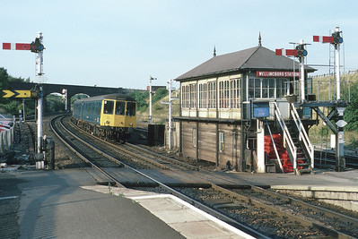 In 1986, the Midland Main Line between Bedford and Leicester was the last stretch of four-track railway in the country to retain semaphore signalling. Here I have caught a class 105 dmu on the 17.10 Kettering-Bletchley passing the station signalbox at Wellingborough. 'Train Coming', says the illuminated board next to the crossing - all that kind of paraphernalia would soon be gone. 4/9/86