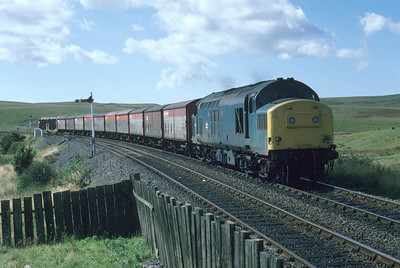 In 1986 there was still healthy rail traffic to the port at Stranraer, as evidenced by this shot of 37221 approaching Glenwhilly. Large sums of money were spent on improving the A75 around this time and, unsurprisingly, the traffic was all switched to lorries. 8/9/86