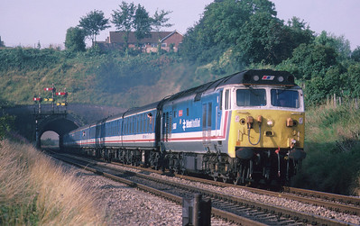 50037 hammers away from Rainbow Hill Tunnel, Worcester with Pathfinder Tours' 'Yorkshire Venturer' from Swindon to Scarborough and Hull. 7/8/88