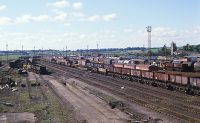 What a scene! Severn Tunnel Junction marshalling yard was one of those places of pilgrimage where you could always expect something interesting, whether it was an unusual loco on the stabling point or something passing on the main line. In September 1987, the yard was about to be closed so this view serves as a reminder of better days. The background here is now scarred by the new M4 to the Second Severn Crossing and all you can hear between passing trains is the roar of traffic. 26/9/87