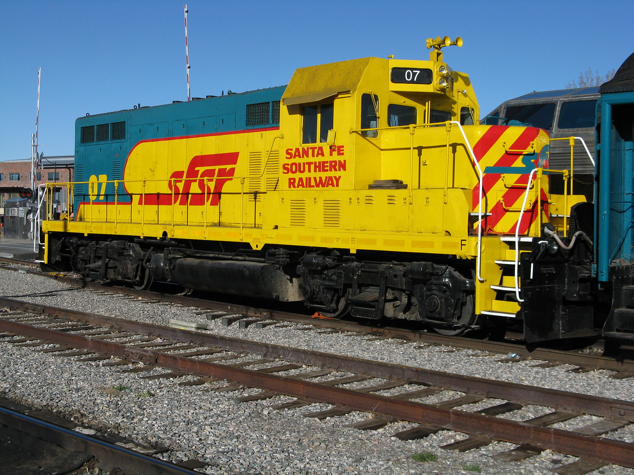 This engine looked like an EMD GP-20 to me.  It was sitting at the railway station in Santa Fe, attached to passenger cars.  I think it runs excursions on the weekends.