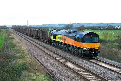 On the first day of operation Colas Rail Freight's 66847 (Ex Freightliner 66574) heads the 6Z50 09.05 Gloucester New Yard to Heathfield empty timber KFA's for loading and return to Chirk, is seen passing Middle Street, Brent Knoll. Monday 5th December 2011.
