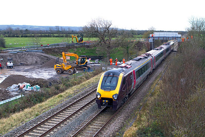 220024 forming the 09.25 Plymouth to Edinburgh passes the construction site for the new road bridge in Wick Road, Hewish. 20/12/2011.