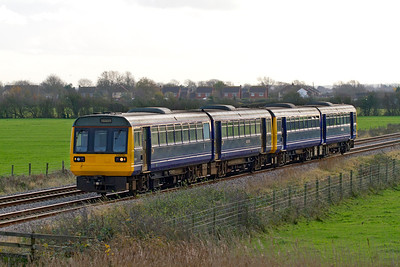 Although the destination blind states Newport, they are infact the final two Class 142's returning off lease to FGW passing Middle Street, Brent Knoll as 5Z42 12.29 Exeter to Newton Heath Depot. 30th November 2011.