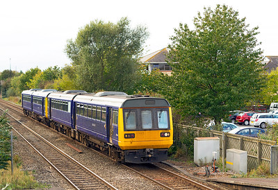 Returning Donkeys, 142064 & 142029 pass Worle Parkway returning to Northern Rail after long term lease to First Great Western running as 5Z42 12.29 Exeter Fuelling Point to Newton Heath Depot. Friday 21st October 2011.