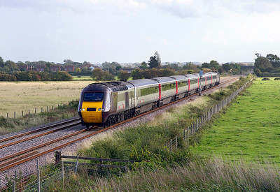The 15.23 Plymouth to Leeds Cross Country service with power cars 43357 and 43303 pass Brent Knoll. 22/09/2011