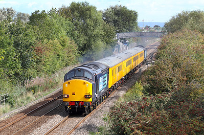 Having been held at St Georges for 15 minutes due to a late running Voyager service, 37059 & 37604 power past Worle Parkway with 1Q13 Radio Survey train from Bristol to Taunton. 14/09/2011