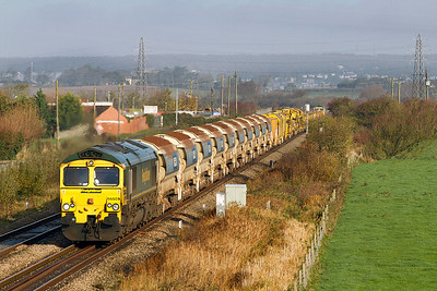 66559 leads the Track Replacement Train as the 6Y33 07.32 Stoke Works Junction to Taunton Fairwater Yard past Lympsham with 66551 on the rear. Saturday 12th November 2011.