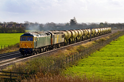 47375 with 56302 DIT pass Middle Street, Brent Knoll with 6Z23 10.00 Burngullow to Burton-on-Trent silver bullet wagon move. The wagons are for refurbishment for work in Scotland. 30th November 2011.