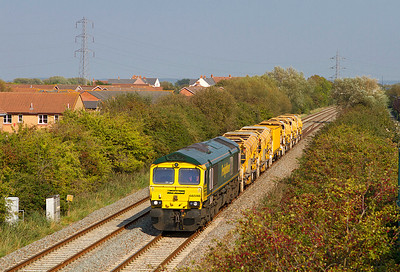 66598 heads along the Weston-super-Mare avoiding line at Locking Castle with 6Z26 10.15 Rugby Depot to Taunton Fairwater Yard returning part of the HOBC. Monday 3rd October 2011.