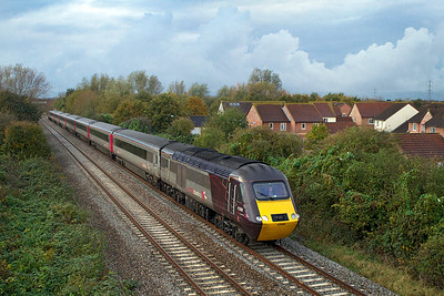 Under a dramatic sky 43366 & 43301 have charge of 13.23 Plymouth to Edinburgh on the Weston-super-Mare avoiding line at Locking Castle, Friday 4th November 2011.