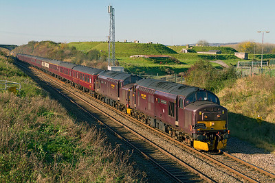 37676 'Loch Rannoch' & 37685 'Loch Arkaig' head 'Spitfire Tours' 1Z27 10.30 Exeter to Preston tour past the fuel dump at Flax Bourton with 57601 on the rear providing ETS. Sunday 6th November 2011.