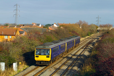 More Class 142's returning after long term lease to FGW. 142009, 142068 & 142063 head along the Weston-super-Mare avoiding line at Locking Castle as 5Z42 12.29 Exeter to Newton Heath. 142063 will be dropped off at St. Phillips Marsh Depot for tyre turning before continuing to Newton Heath. Monday 28th November 2011.